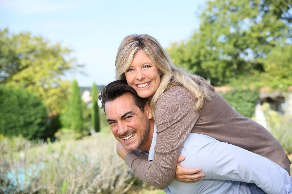 Couple Outdoors smiling | Parker, CO Dentist