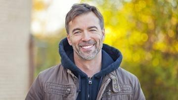 Man smiling outdoors | Dentist in Parker CO